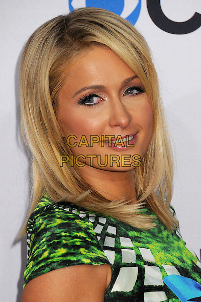 Paris Hilton.People's Choice Awards 2013 - Arrivals held at Nokia Theatre L.A. Live, Los Angeles, California, USA..January 9th, 2013.headshot portrait blue black green yellow turquoise pattern print side  .CAP/ADM/BP.©Byron Purvis/AdMedia/Capital Pictures.