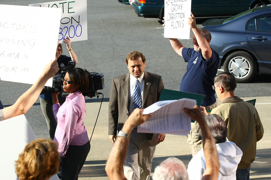 Congressman Tom Perriello walks through protestors on his way to meeting with Organizing for America (OFA), a grassroots project of the Democratic National Committee (DNC) dedicated to supporting the Presidentís agenda for change, who thanked him for his support with the health care reform Tuesday in Charlottesville. .. Photo/Andrew Shurtleff......