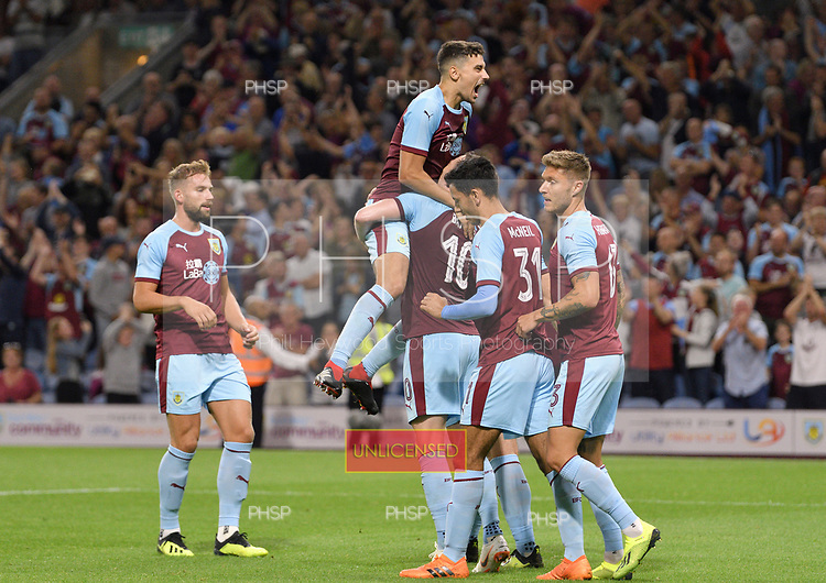 02/08/2018 Europa League Second Qualifying Round 2nd leg Burnley v Aberdeen<br /> <br /> Ashley Barnes congratulated by Ashley Westwood after scoring from the penalty spot in extra time