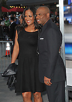 Laila Ali, daughter of Muhammed Ali, &amp; husband Curtis Conway at the Los Angeles premiere of &quot;Draft Day&quot; at the Regency Village Theatre, Westwood.<br /> April 7, 2014  Los Angeles, CA<br /> Picture: Paul Smith / Featureflash