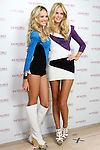 "Candice Swanepoel and Erin Heatherton pose together during the ""Incredible by Victoria's Secret"" launch at the Victoria Secret SOHO Store, August 10, 2010."