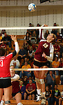SIOUX FALLS, SD - OCTOBER 25:  Tagyn Larson #13 from Roosevelt tries to get a kill past Abigail Wahl #3 from Rapid City Central in the first game of their match Friday night at Roosevelt. (Photo by Dave Eggen/Inertia)