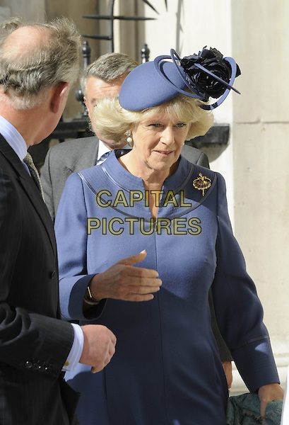 CAMILLA, DUCHESS OF CORNWALL.At a service of Thanksgiving for the renewal of St. Martin-in-the-Fields Church in London, England, .April 28, 2008..half length Parker Bowles royal blue hat jacket ballerina brooch pin hand.CAP/DH.©David Hitchens/Capital Pictures