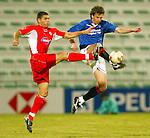 Rangers v Energie Cottbus 18.1.2003, Dubai al sahbab stadium: Dan Eggen clears the danger.