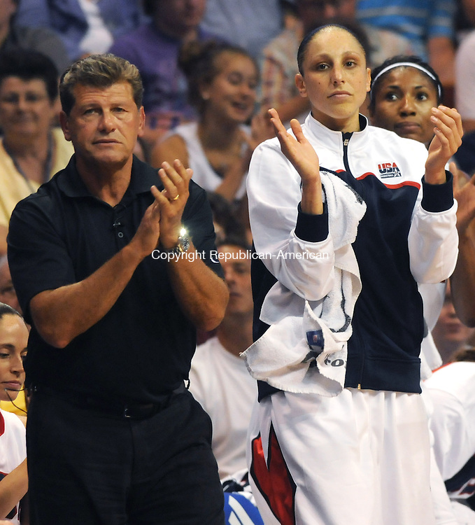UNCASVILLE, CT 10  JULY, 2010-071010JS03-Team USA and UConn head coach Geno Auriemma and Diana Taurasi applaud  a play during Team USA's game against the WNBA All-Stars Saturday at the Mohegan Sun Arena in Uncasville. <br /> Jim Shannon Republican-American