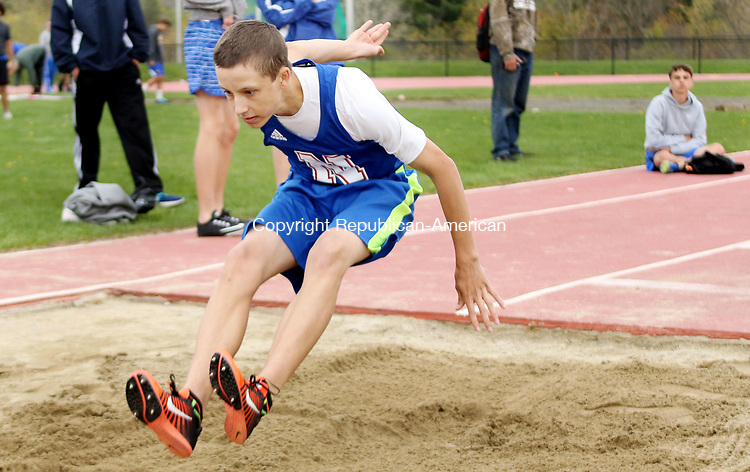 LITCHFIELD CT. 09 May 2017-050917SV12-Austin Grant of Nonnewaug High competes in the long jump during a track meet against Litchfield High and Gilbert High in Litchfield Tuesday. <br /> Steven Valenti Republican-American
