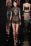"Model walks runway in a black embroidered lace bodysuit with chiffon overskirt from the Reem Acra Fall 2016 ""The Secret World of The Femme Fatale"" collection, at NYFW: The Shows Fall 2016, during New York Fashion Week Fall 2016."