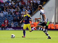 Pictured L-R: Pablo Hernandez of Swansea against Jonas Olsson of West Brom. Sunday 01 September 2013<br />