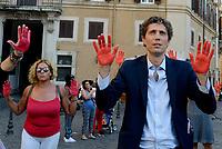 Roma, 24 Luglio 2018<br /> Riccardo Magi<br /> Decine di persone con le mani tinte di rosso a simboleggiare il sangue dei migranti morti in mare, protestano davanti Monte Citorio contro le politiche sull'immigrazione del Governo e del Ministro Salvini