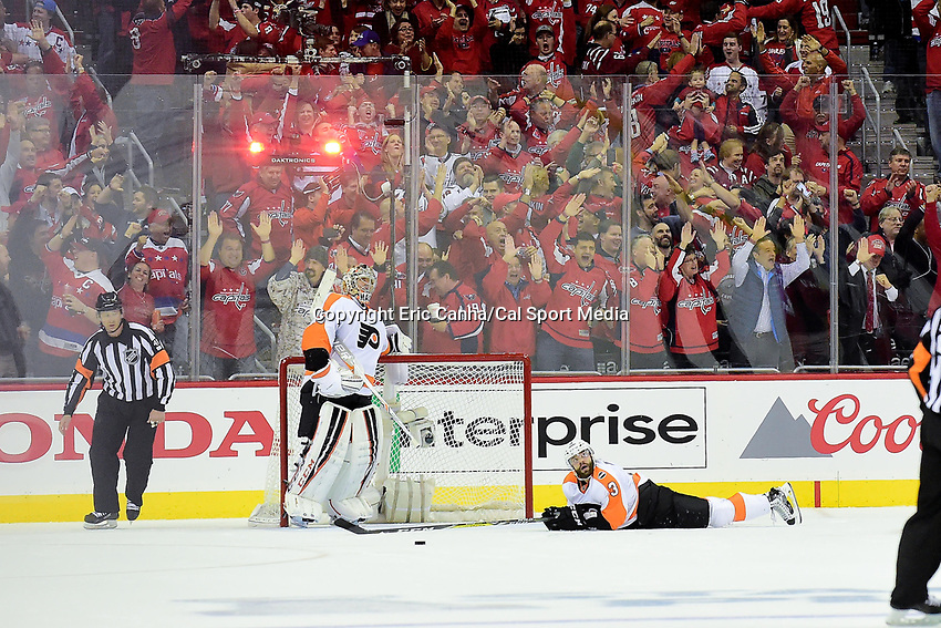 Thursday, April 14, 2016: Philadelphia Flyers goalie Steve Mason (35) and defenseman Radko Gudas (3) react to a goal being scored against their team during the National Hockey League Eastern Conference 1st round game 1 between the Philadelphia Flyers and the Washington Capitals held at the Verizon Center in Washington, DC. Washington defeats Philadelphia 2-0. Eric Canha/CSM