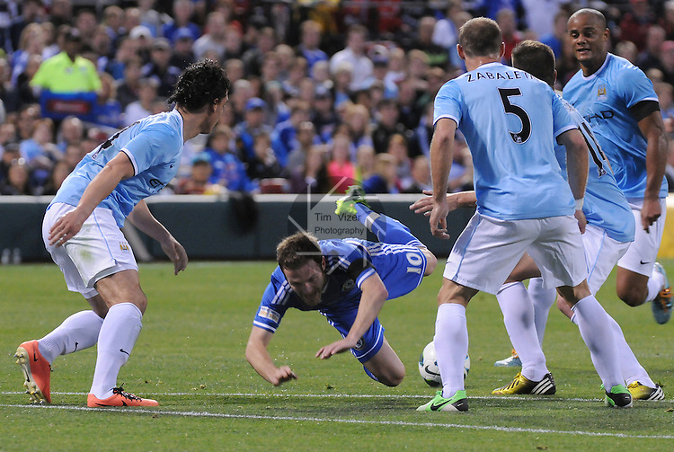 Football - Premier League - Chelsea Training for friendly with Man City St. Louis, MO/USA. Manchester City won, 4-3 over Chelsea.  Chelsea FC player Juan Mata (10) falls to the turf amid a group of Manchester City players late in the first half.