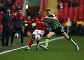 24th March 2018, The Valley, London, England;  English Football League One, Charlton Athletic versus Plymouth Argyle; Aaron Taylor-Sinclair of Plymouth Argyle puts pressure on Mark Marshall of Charlton Athletic