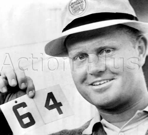 13.04.1965. Augusta, Georgia USA. Smiling Golfer Jack Nicklaus holds up the number 64 - his score on the Augusta National Golf course on April 10th in the third round of the Masters Golf Tournament. 13 April 1965