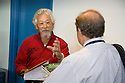 David Suzuki, one of the keynote presenters at West Coast Green, speaks with an attendee. Suzuki is an award-winning scientist, environmentalist and broadcaster (The Nature of Things). West Coast Green is the nation?s largest conference and expo dedicated to green innovation, building, design and technology. The conference featured over 380 exhibitors, 100 presenters, and 14,000 attendees. Location: San Jose Convention Center in Silicon Valley (San Jose, California, USA), September 25-27, 2008
