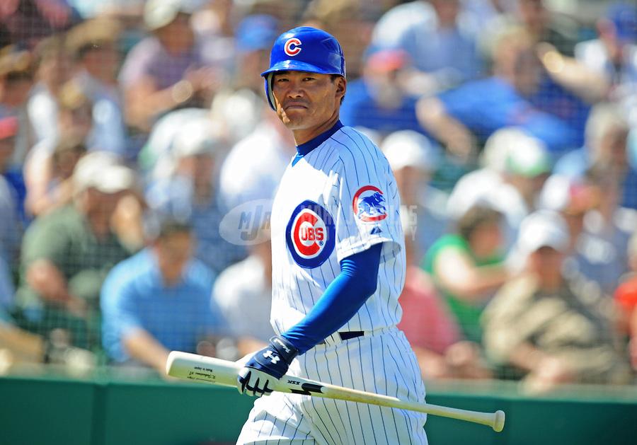 Mar 20, 2008; Mesa, AZ, USA; Chicago Cubs right fielder Kosuke Fukudome against the Colorado Rockies at HoHoKam Park. Mandatory Credit: Mark J. Rebilas-