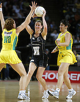 Silver Ferns Adine Harper looks to pass around Australians Alison Broadbent and Natalie Avellino during the netball test match between the Silver Ferns v Australia played at the Sydney Superdome, Sydney Australia, 29th June 2005. The Silver Ferns won 50-43. ©Michael Bradley