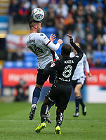 Bolton Wanderers' Gary Madine competing in the air<br /> <br /> Photographer Andrew Kearns/CameraSport<br /> <br /> The EFL Sky Bet Championship - Bolton Wanderers v Leeds United - Sunday 6th August 2017 - Macron Stadium - Bolton<br /> <br /> World Copyright &copy; 2017 CameraSport. All rights reserved. 43 Linden Ave. Countesthorpe. Leicester. England. LE8 5PG - Tel: +44 (0) 116 277 4147 - admin@camerasport.com - www.camerasport.com