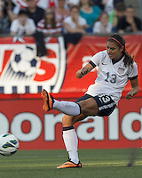 USWNT forward Alex Morgan (13) takes a shot. In an international friendly, the U.S. Women's National Team (USWNT) (white/blue) defeated Korea Republic (South Korea) (red/blue), 4-1, at Gillette Stadium on June 15, 2013.