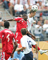 Peter Crouch of England uses his height to beat Cyd Gray of Trinidad to the ball. England defeated Trinidad & Tobago 2-0 in their FIFA World Cup group B match at Franken-Stadion, Nuremberg, Germany, June 15 2006.
