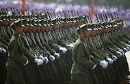 Beijing, China. October 1st, 1984. This huge parade is for the celebration of the 35th Anniversary of the Chinese Revolution. Few ten of thousand of various millitary troops walk for hours in front of the crowd.