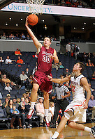 Nov 6, 2010; Charlottesville, VA, USA; Roanoke College f Dylan Berry (30) shoots the ball in front of Virginia Cavaliers g Joe Harris (12) Saturday afternoon in exhibition action at John Paul Jones Arena. The Virginia men's basketball team recorded an 82-50 victory over Roanoke College.