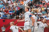 June 16, 2015: Abby WAMBACH of the USA heads the ball during a Group D match at the FIFA Women's World Cup Canada 2015 between Nigeria and the USA at BC Place Stadium on 16 June 2015 in Vancouver, Canada. USA won 1-0. Sydney Low/Asteriskimages.com