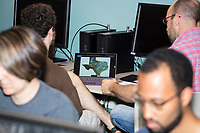 Justin Solomon (red plaid right) speaks with Assaf Bar-Natan at the Metric Geometry and Gerrymandering Group (MGGG) hackathon at the Data Lab in the Tisch Library at Tufts University in Medford, Massachusetts, USA, on Thurs., Aug. 10, 2017. Solomon is the organizer of the hackathon and an Assistant Professor in MIT's Computer Science and Artificial Intelligence Laboratory (CSAIL) and Department of Electrical Engineering and Computer Science (EECS). Bar-Natan, 24, of Toronto, Ontario, Canada, is a Ph.D. student in Mathematics at the University of Toronto and is the summer intern of the MGGG. The hackathon is part of the first in a series of Geometry of Redistricting workshops put on by the MGGG. Academics, Geographic Information Systems (GIS) professionals, and legal professionals worked together to build tools useful in analyzing voting district data around the country.