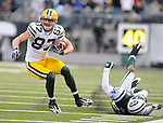 Green Bay Packers receiver Jordy Nelson, left, makes a catch near the sideline ahead of New York Jets' Marquice Cole during the fourth quarter of the game at The New Meadowlands Stadium in East Rutherford, NJ on Oct. 31, 2010.