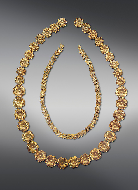 Mycenaean gold necklace from the Mycenaean cemetery of Midea tholos tomb , Dendra, Greece. National Archaeological Museum Athens. Grey Background<br /> <br /> Inside mycenaean necklace has gold ivy leaf beads, Cat No 7354. The outer mycenaean necklace has rosette shaped gold beads, Cat No 7342. 15th-14th century BC.