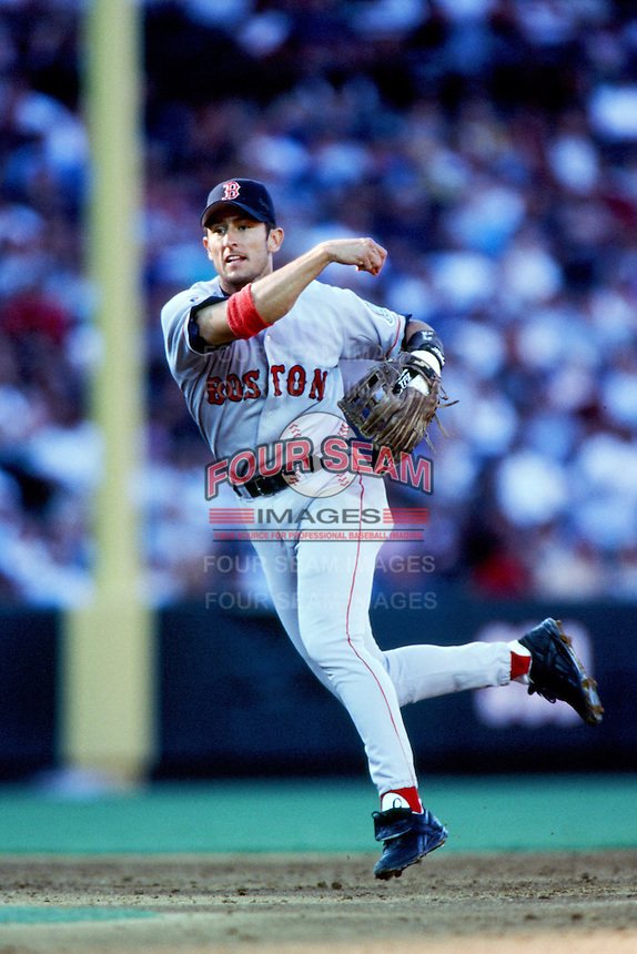 Nomar Garciaparra of the Boston Red Sox makes a throw from shortstop during a 1999 Major League Baseball season game against the Anaheim Angels in Anaheim, California. (Larry Goren/Four Seam Images)
