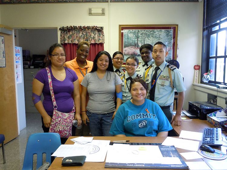L to R: Blood donor/alumna Fernanda Lopez (class of 2012, CJ teacher Ms. Lewis, and donor/alumna Diana Lopez (class of 2010) with ROTC blood drive workers Citlaly Rubio, Marcia Ramirez, Isaaca Johnson, and Freddy Maraviela with LECJ school nurse Celeste Adams in her office.