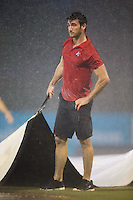 Kannapolis Intimidators intern Colton Dalberth assists with puling the tarp during the South Atlantic League game against the West Virginia Power at Intimidators Stadium on July 3, 2015 in Kannapolis, North Carolina.  The Intimidators defeated the Power 3-0 in a game called in the bottom of the 7th inning due to rain.  (Brian Westerholt/Four Seam Images)