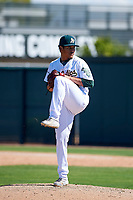 Oakland Athletics pitcher Jean Ruiz (64) delivers a pitch to the plate during an Instructional League game against the Cincinnati Reds on September 29, 2017 at Lew Wolff Training Complex in Mesa, Arizona. (Zachary Lucy/Four Seam Images)