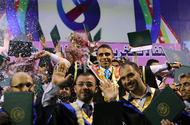 Palestinian students participate in their graduation ceremony at the Islamic University in Gaza city on July 23, 2016. Photo by Mohammed Asad