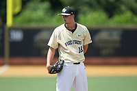 Wake Forest Demon Deacons relief pitcher Carter Bach (18) looks to his catcher for the sign against the Pitt Panthers at David F. Couch Ballpark on May 20, 2017 in Winston-Salem, North Carolina. The Demon Deacons defeated the Panthers 14-4.  (Brian Westerholt/Four Seam Images)