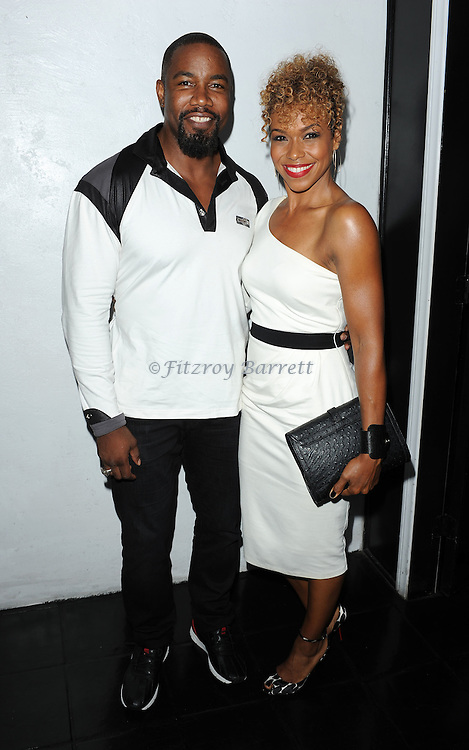 Michael Jai White and date arriving at Vivica A. Fox's Fabulous 50th Birthday Celebration held at the Philippe Chow Beverly Hills, Ca. August 2, 2014.