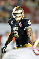 January 7, 2013: Notre Dame linebacker Manti Te'o (5)  during 2nd half game action of the Discover BCS National Championship game between the Alabama Crimson Tide and the Notre Dame Fighting Irish. Alabama defeated Notre Dame 42-14 at Sun Life Stadium in Miami Gardens, Fl