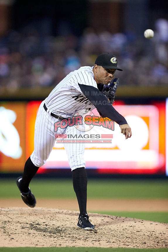 Charlotte Knights relief pitcher Jeanmar Gomez (9) delivers a pitch to the plate against the Toledo Mud Hens at BB&T BallPark on June 22, 2018 in Charlotte, North Carolina. The Mud Hens defeated the Knights 4-0.  (Brian Westerholt/Four Seam Images)
