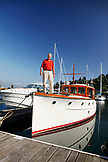 USA, California, San Francisco, Peter Johnson stands on the bow of his 1927 Stevens, the San Francisco Yatch Club, Tiburon