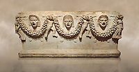 """Picture of Roman relief sculpted Sarcophagus of Garlands, 2nd century AD, Perge. This type of sarcophagus is described as a """"Pamphylia Type Sarcophagus"""". It is known that these sarcophagi garlanded tombs originated in Perge and manufactured in the sculptural workshops of Perge. Antalya Archaeology Museum, Turkey.. Against a warm art background."""