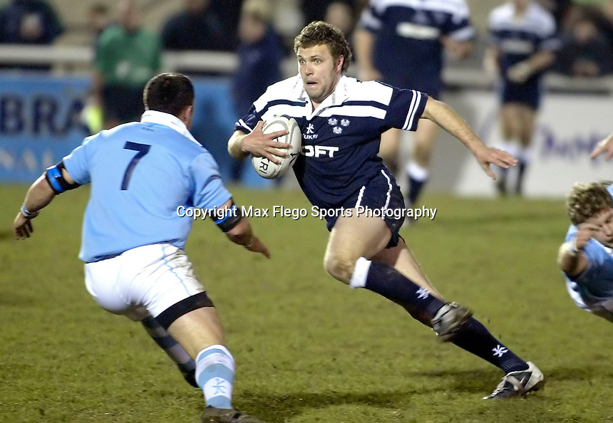 Cambridge University / Oxford University..24th PCubed Student Rugby League Varsity Match..Richmond Athletic Ground, March 3, 2004..Pic : Max Flego... Graham Barr goes on an electrifying run for Oxford..