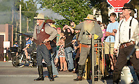 NWA Democrat-Gazette/BEN GOFF @NWABENGOFF<br /> A crowd watches as the sheriff and civilians return fire on bank robbers on Friday Sept. 4, 2015 during a re-enactment of an 1893 bank robbery during First Friday September: Sugar Creek Days on the Bentonville square. The re-enactment was based on the June 5, 1893 robbery in which outlaw Henry Starr and five men made off with cash from the People's Bank of Bentonville after a shootout with civilians and the sheriff.