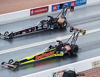 Oct 29, 2016; Las Vegas, NV, USA; NHRA top fuel driver J.R. Todd (near) races alongside Scott Palmer during qualifying for the Toyota Nationals at The Strip at Las Vegas Motor Speedway. Mandatory Credit: Mark J. Rebilas-USA TODAY Sports