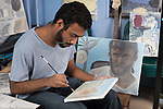 Young man artist at work in home studio, oil painting, self portrait nearby