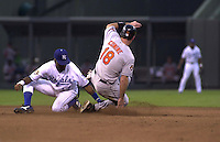 Baltimore's first baseman Jeff Conine is tagged out by Royals short stop Neifi Perez on an attempted steal of 2nd base in the 4th inning on August 7, 2001.  The Orioles won 7-3.