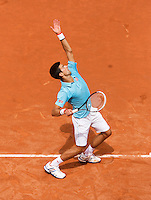 France, Paris, 30.05.2014. Tennis, French Open, Roland Garros, Novak Djokovic (SRB) in action in his match against Marin Cilic (CRO) <br /> Photo:Tennisimages/Henk Koster