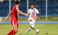 GEORGETOWN, GRAND CAYMAN, CAYMAN ISLANDS - NOVEMBER 19: Weston McKennie #8 of the United States turns and moves with the ball during a game between Cuba and USMNT at Truman Bodden Sports Complex on November 19, 2019 in Georgetown, Grand Cayman.