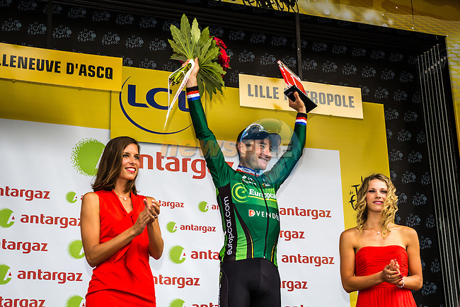 Thomas Voeckler (FRA) Team Europcar takes the combativity prize at the end of Stage 4 of the 2014 Tour de France running 163.5km from Le Touquet to Lille. 8th July 2014.<br /> Picture:Thomas van Bracht/Peloton Photos/www.newsfile.ie