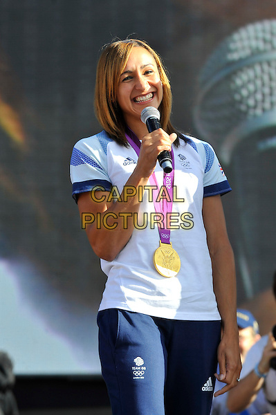 Jessica Ennis .Gold Medal Winner for Team GB, attending BT London Live, Hyde Park, London, England. .5th August 2012.heptathlon  track and field athlete  half smiling length white t-shirt blue tracksuit medal track and field athlete  microphone .CAP/MAR.© Martin Harris/Capital Pictures.