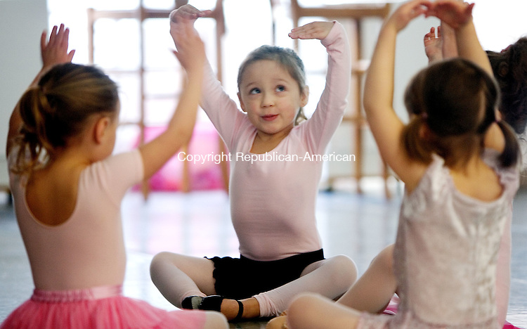 WOODBURY, CT. 30 January 2012-013012SV01-Jennifer Cardenas, 4, of Southbury tries a few ballet moves during a class for 3-4 year olds at the Main Street Center for the Arts in Woodbury Monday. During the 45-minute class, the small dancers use music, dance and props to stimulate their imaginations, build coordination and learn the fundamentals of ballet technique. .Steven Valenti Republican-American